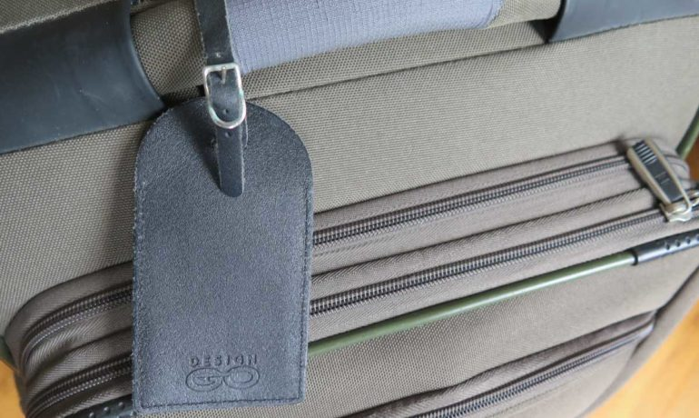 Image of a black luggage tag on a suitcase