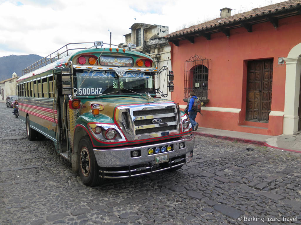 a 'chicken bus' driving through the streets of antigua guatemala