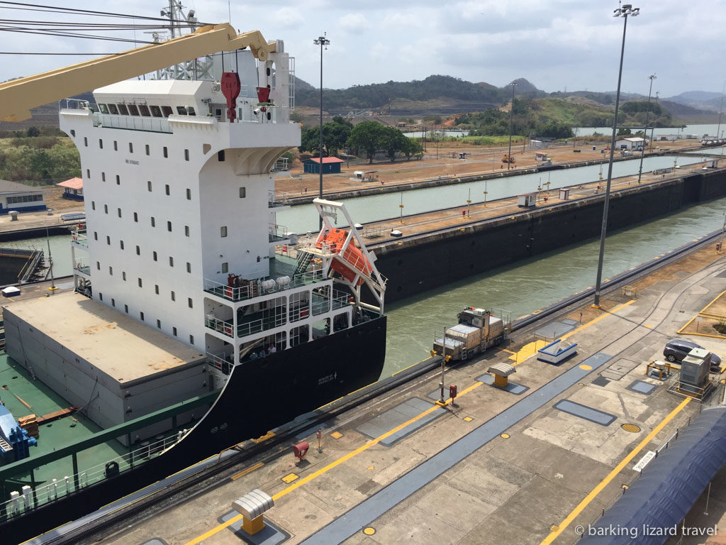 a boat going through the panama canal at the miraflores locks