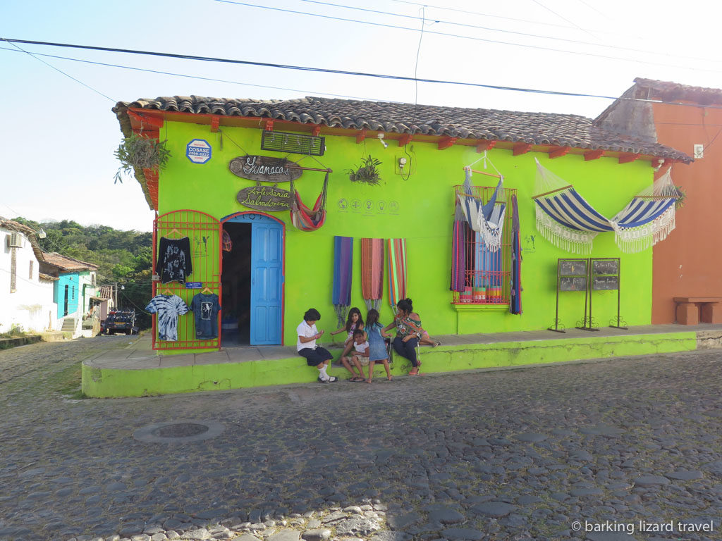 A colourful lime green store front in Suchitoto