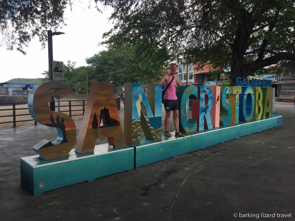 a photo of lydia standing on the san cristobal sign