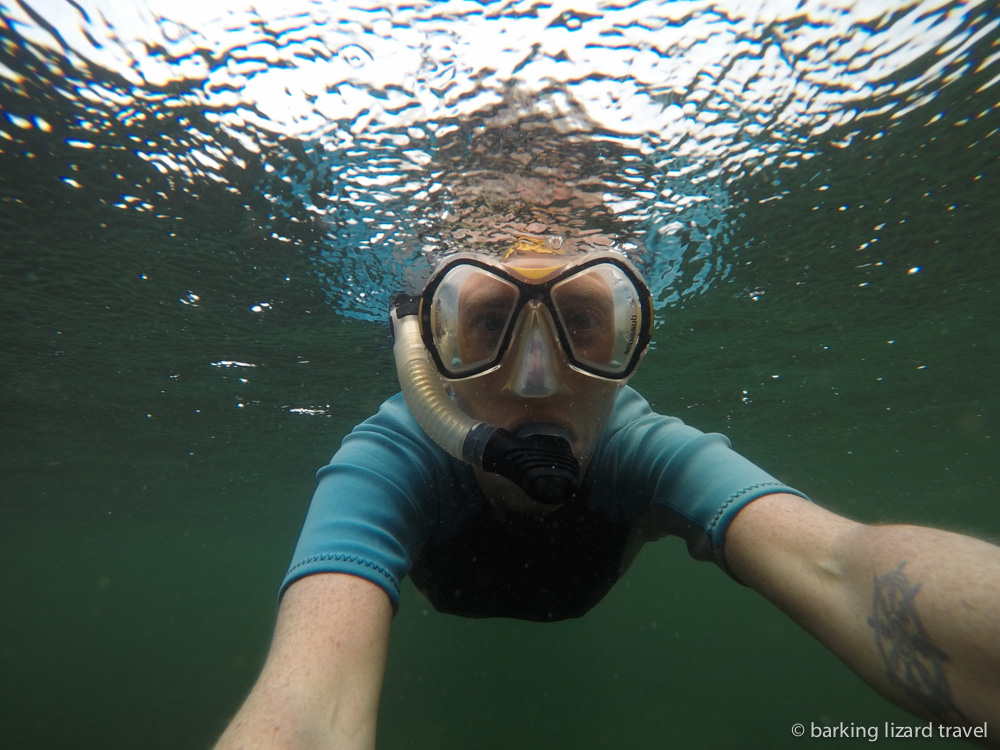 lydia snorkelling in the rain at los tuneles, galapagos islands