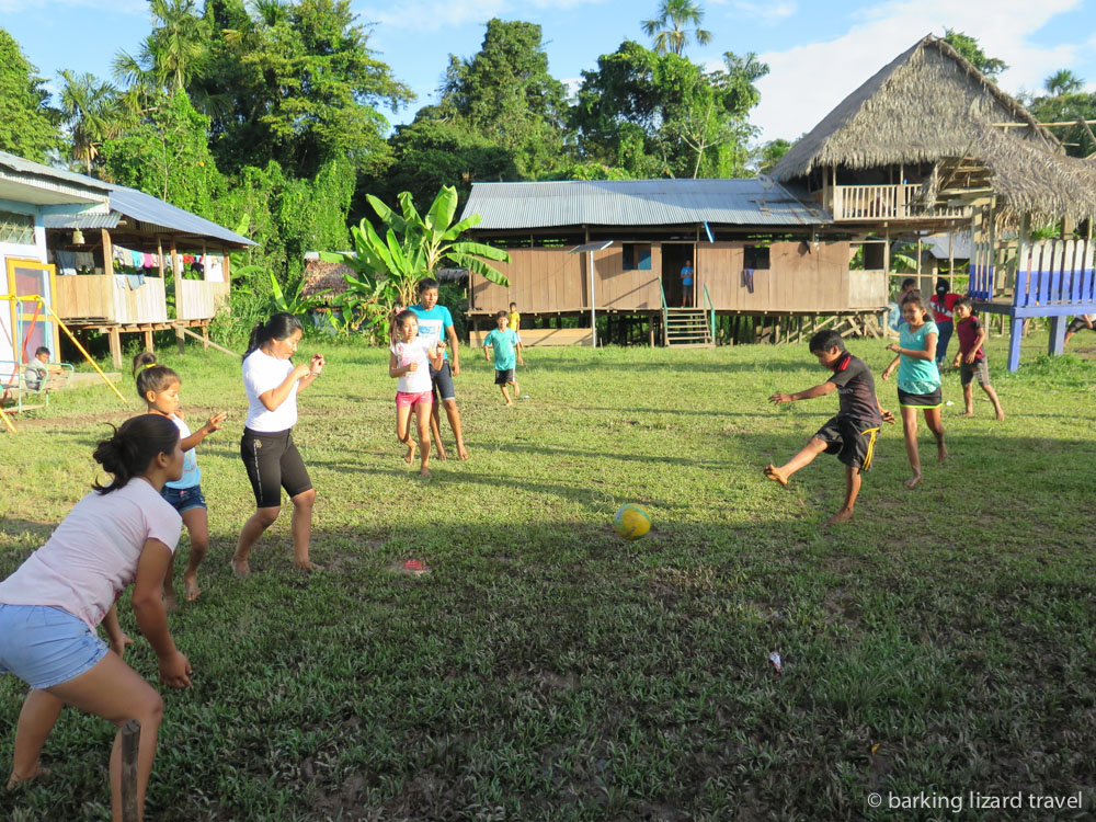 A photo of villagers playing a game of football in the Peruvian Amazon rainforest