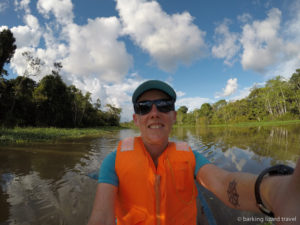 photo of lydia bigley in a small canoe on a river in amazon rainforest