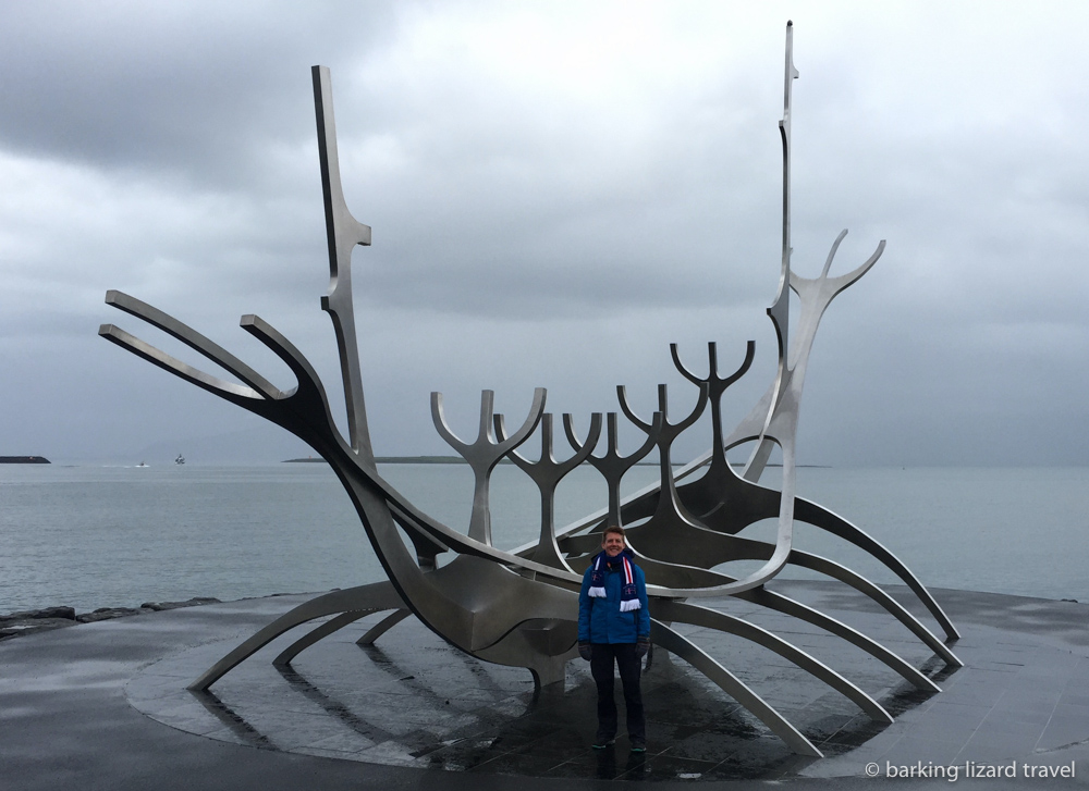 photo of Lydia in front of the Sun Voyager sculpture in Reykjavík Iceland